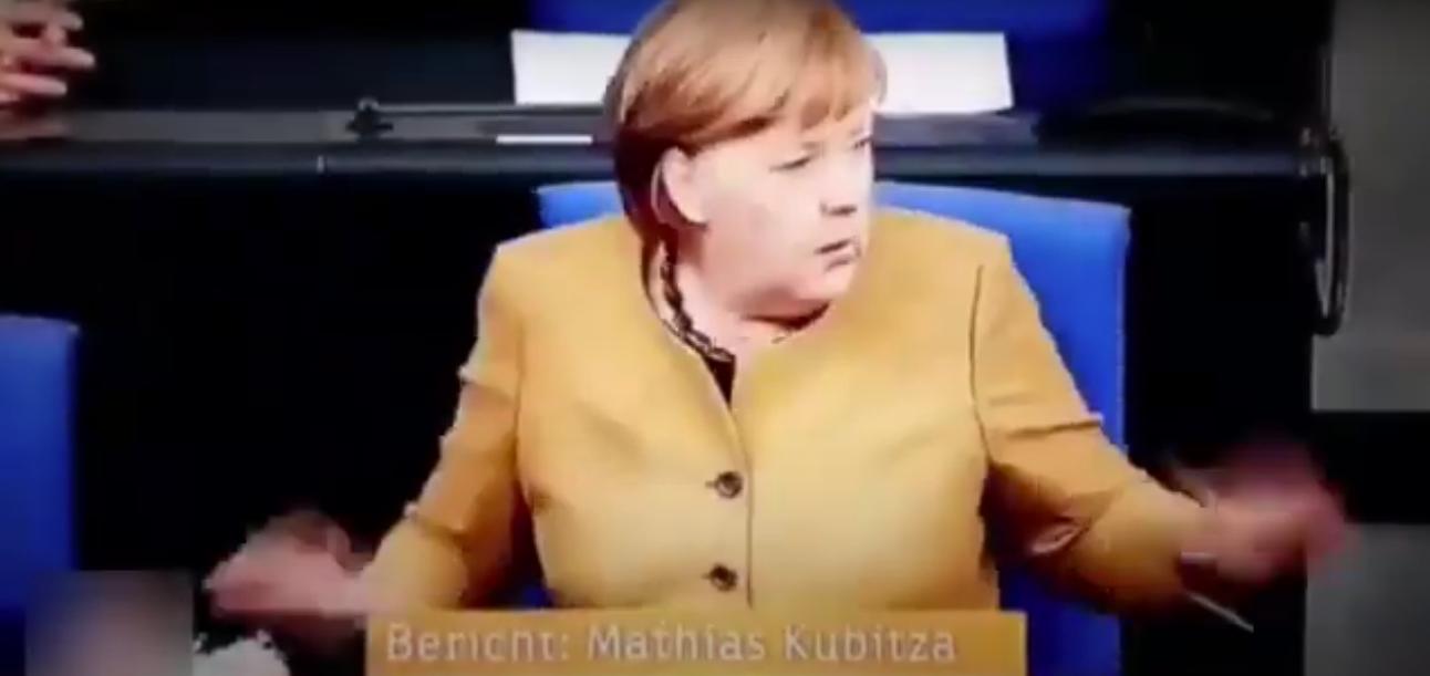 Меркель зауважила, що її маска залишилася на трибуні