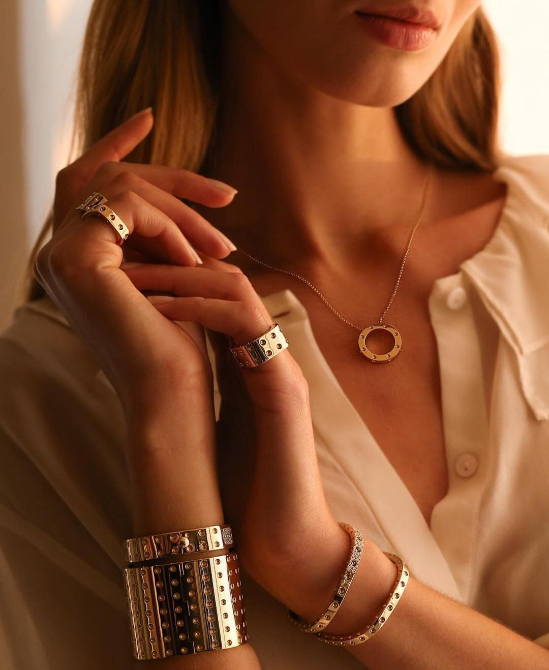 Многослойные браслеты из золота