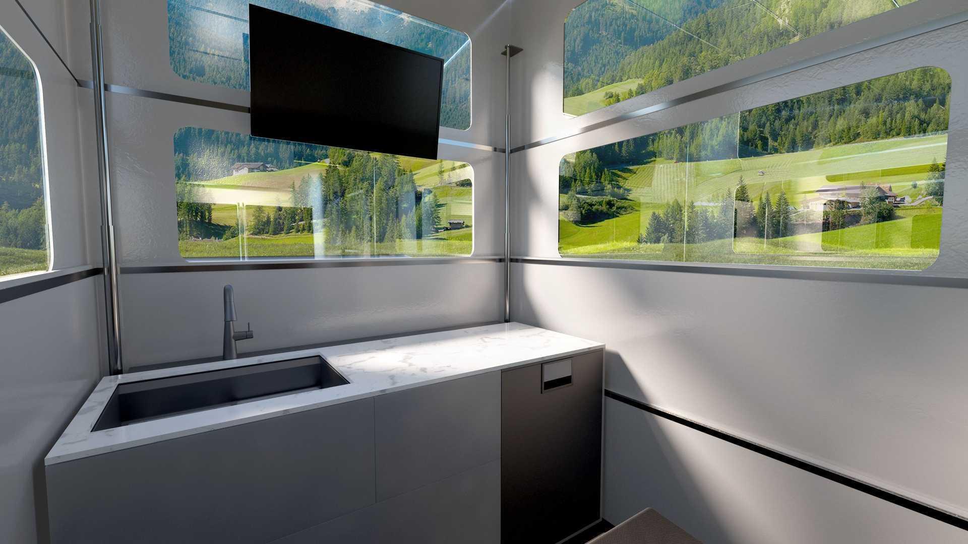 Всередині є велика кімната, яка вміщує у собі кухню, вітальню та спальню
