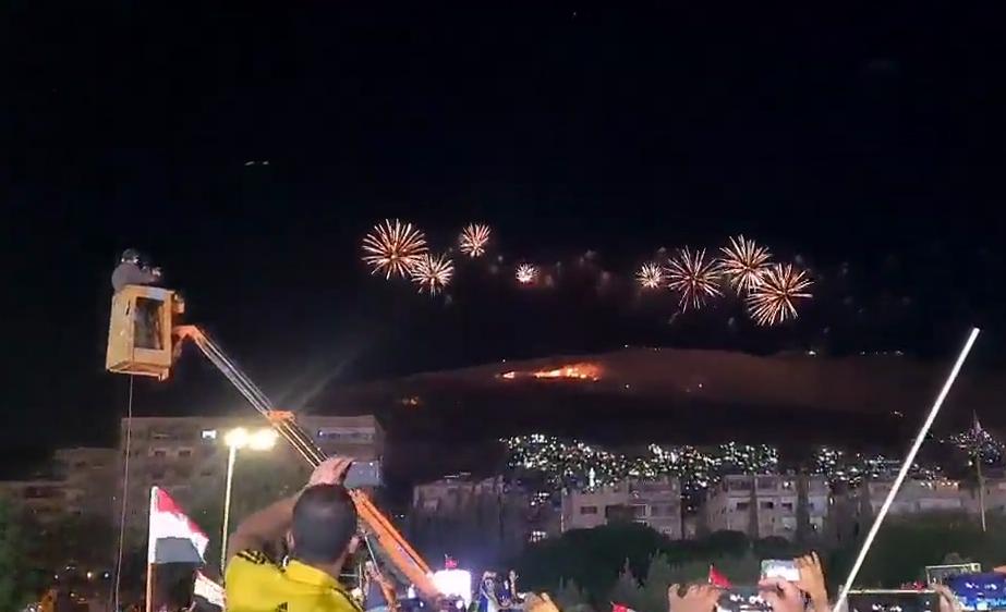 Празднование победы Асада в Дамаске.