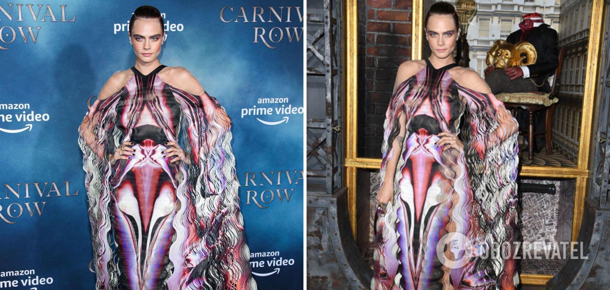 Кара Делевинь вышла в платье с абстрактным принтом и прорезами.