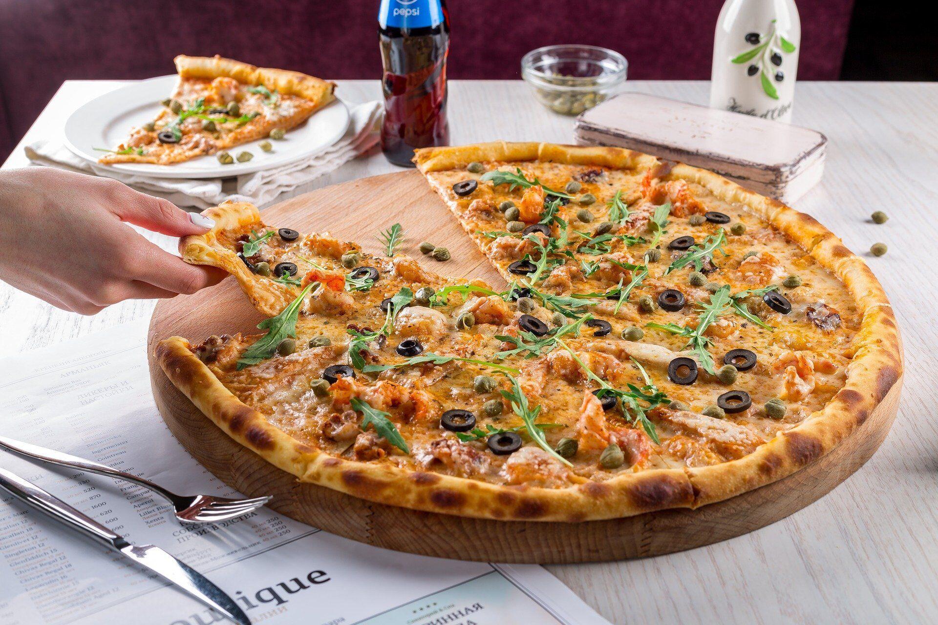 Для вкусного приготовления настоящей пиццы следует использовать печь