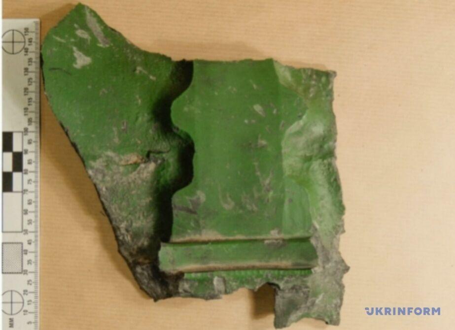 Фрагменты боеприпаса после взрыва
