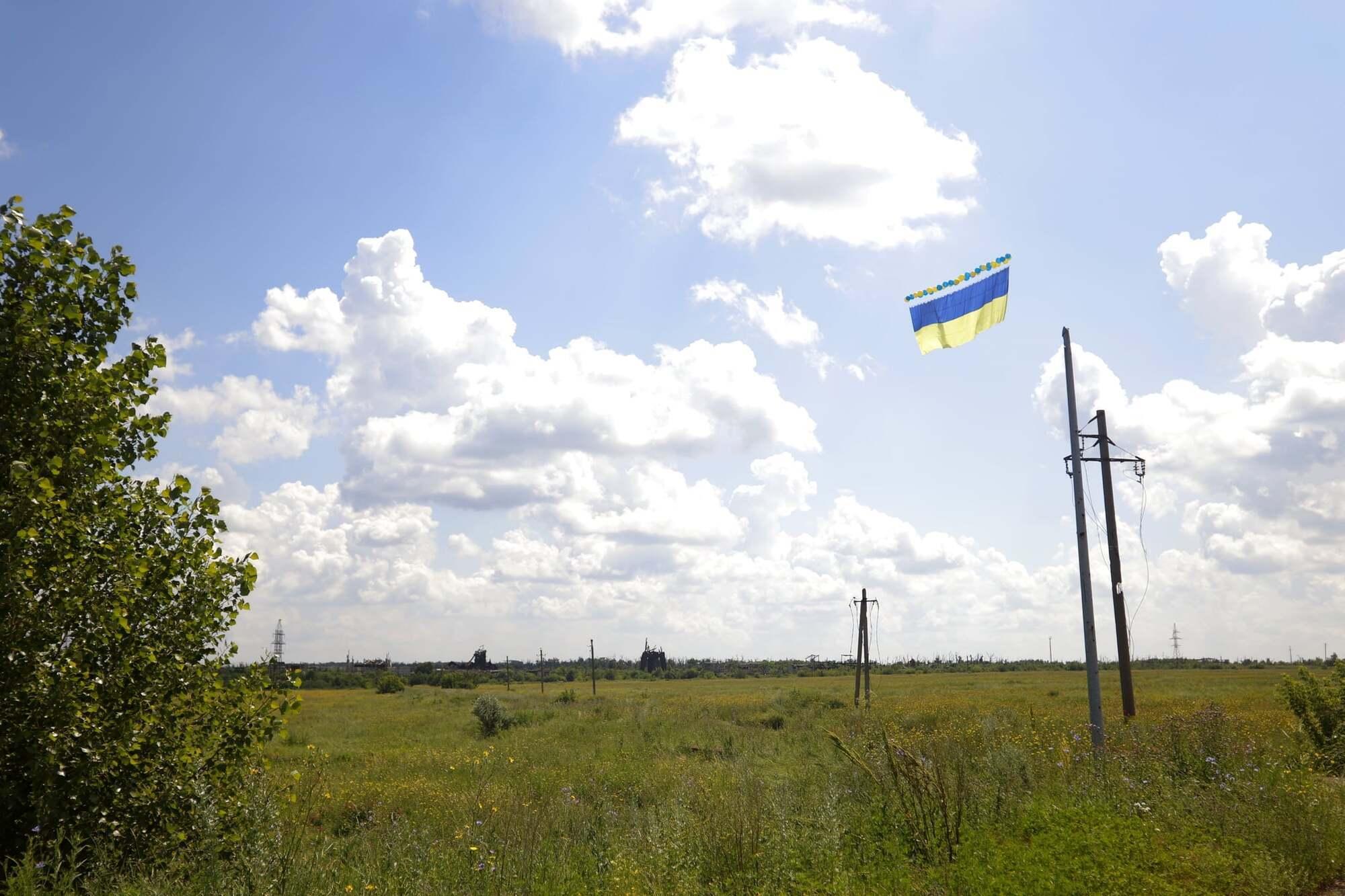 Прапор є нагадуванням місцевому населенню, що про них пам'ятають