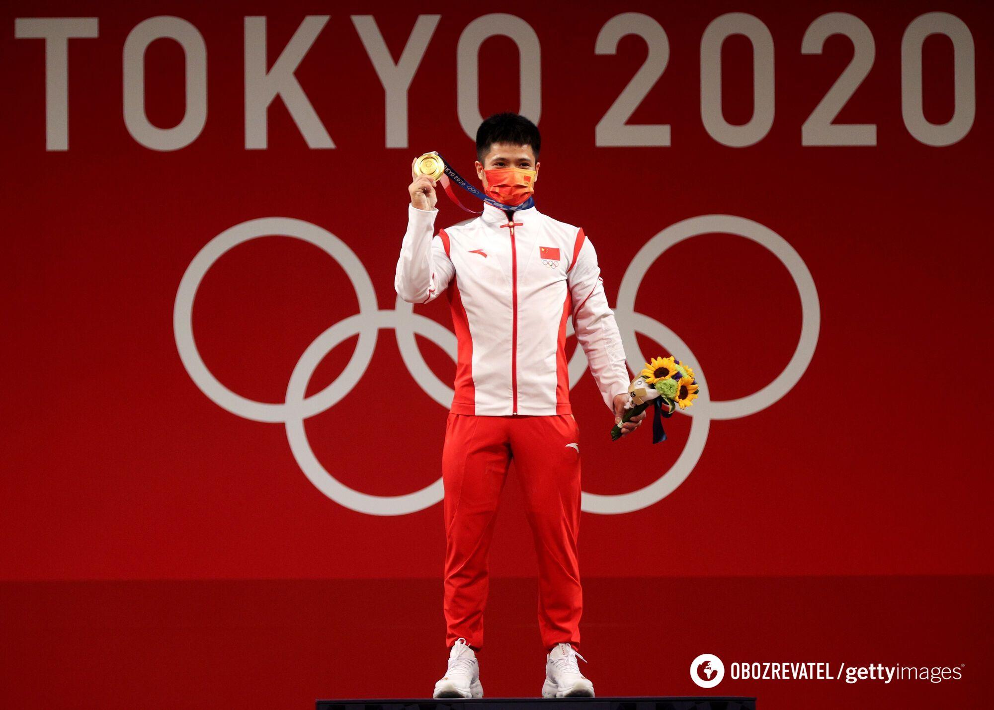 Ли Фабин с медалью