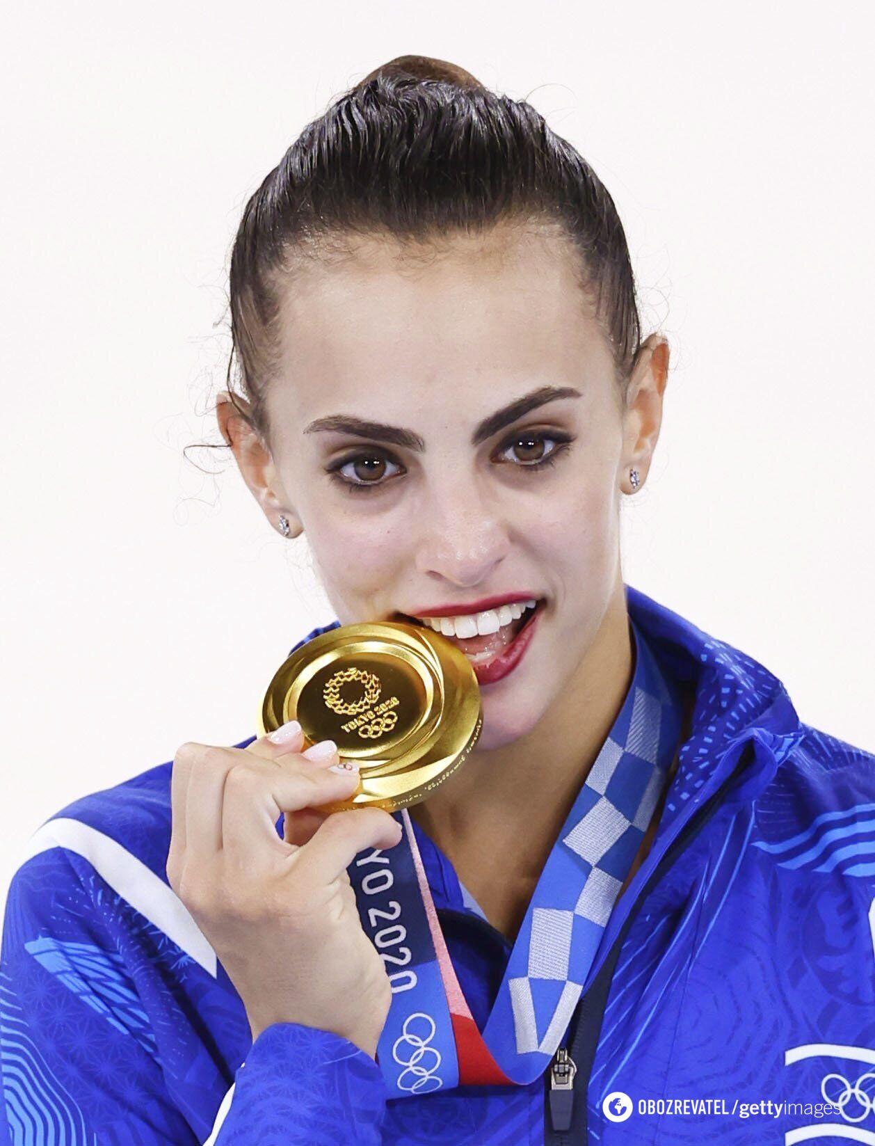 Ліной Ашрам із золотою медаллю