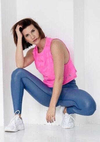 Анита Луценко – фитнес-тренер.