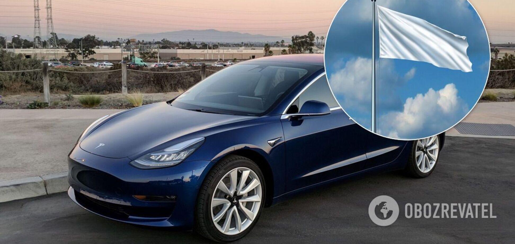 Автопилот Tesla перепутал флаг на АЗС со светофором