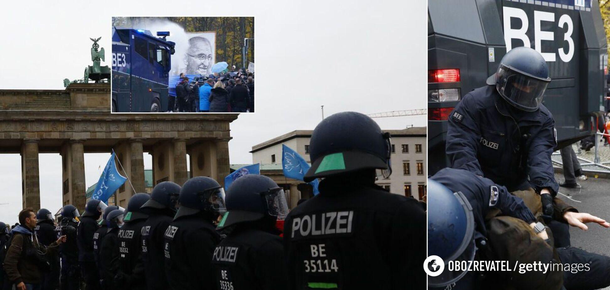 Берлин вышел на массовый протест из-за карантина: полиция применила водометы, сотни задержанных. Фото и видео