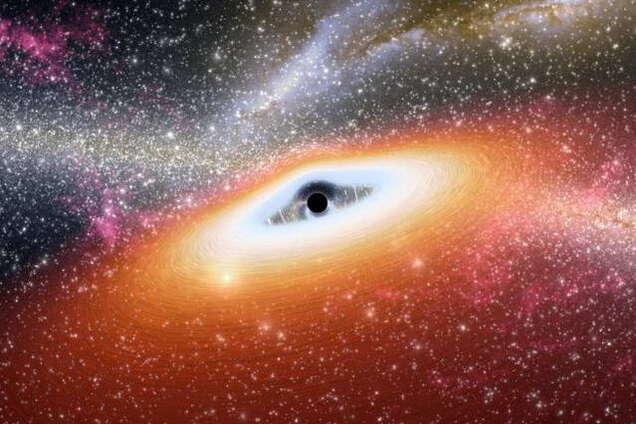 """Ученые сделали """"реальный"""" снимок черной дыры: как выглядит"""