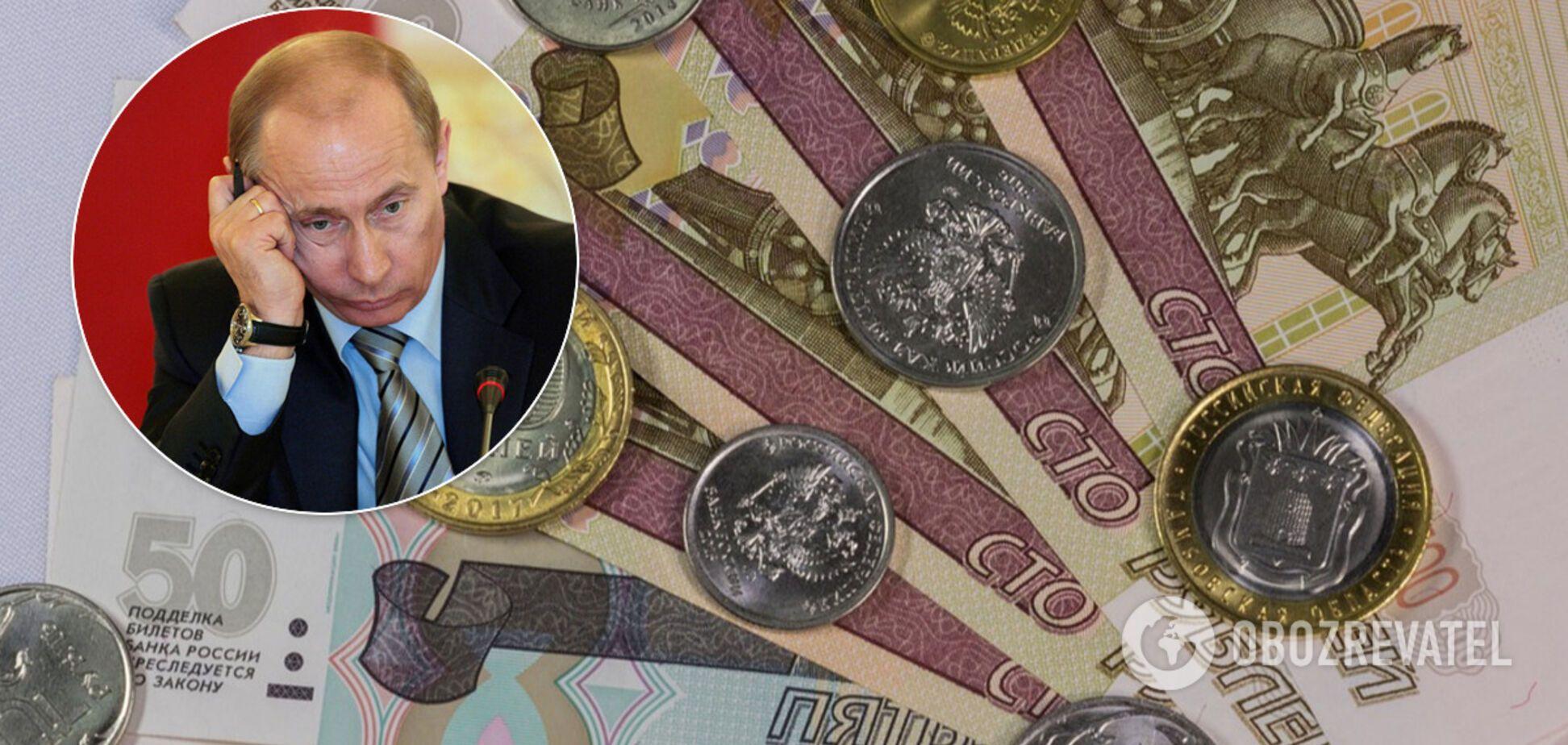 Рубль просів услід за нафтою: що чекає на російську валюту