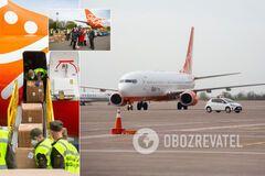 В Украину из Китая прибыл еще один самолет с масками и костюмами. Фото
