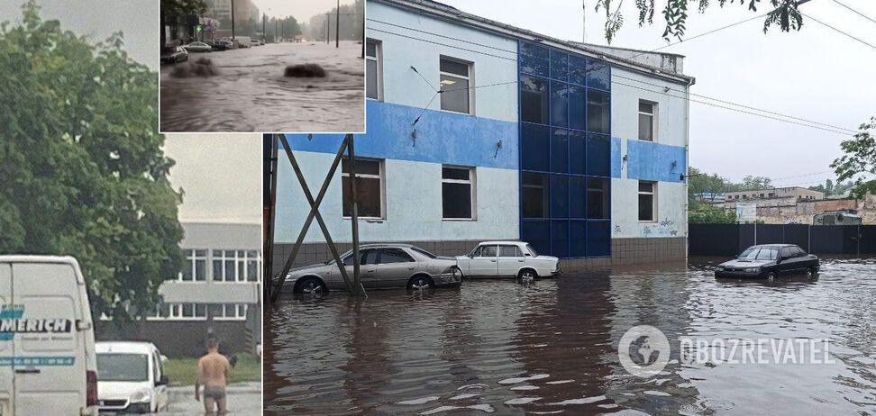 На дорогах бьют гейзеры, авто затопило: города Украины 'поплыли' после дождей. Фото и видео