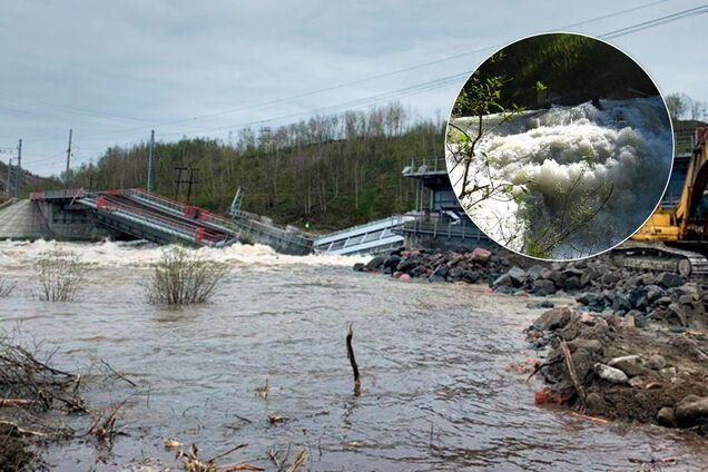 В России река 'смыла' железнодорожный мост. Фото и видео