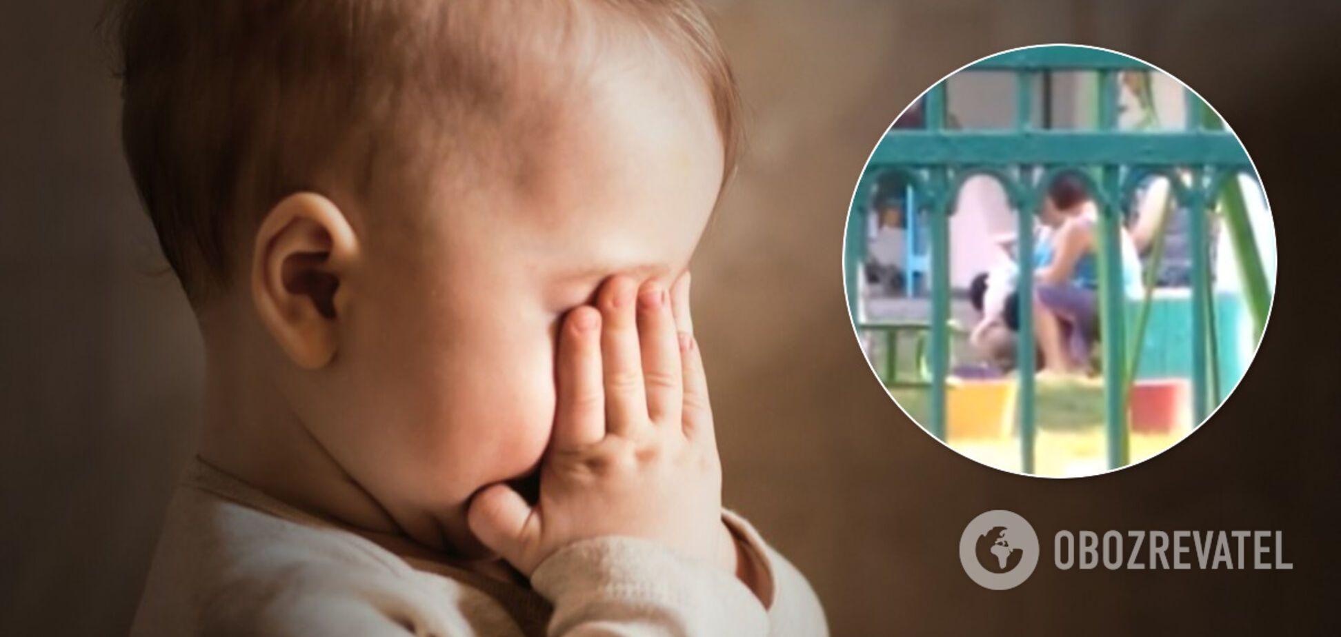 В Каменском медсестра подняла за ноги плачущую малышку: инцидент сняли на видео