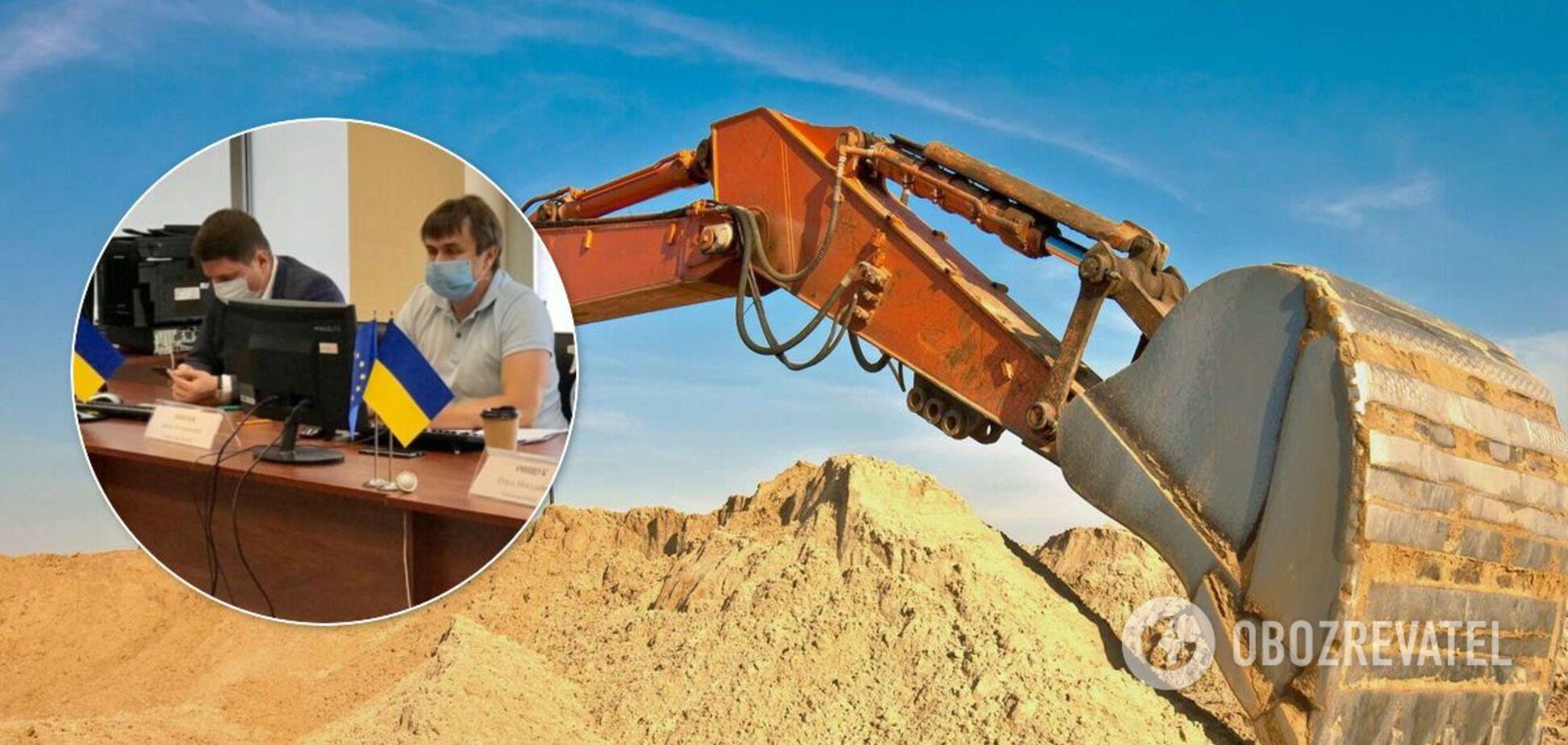 Компанию, связанную с Кучером и Комарницким, уличили в незаконной добыче песка в Киеве