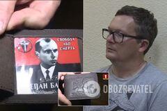 """На белорусском ТВ показали """"организатора"""" акций протеста с кошельком СБУ и календариком Бандеры"""