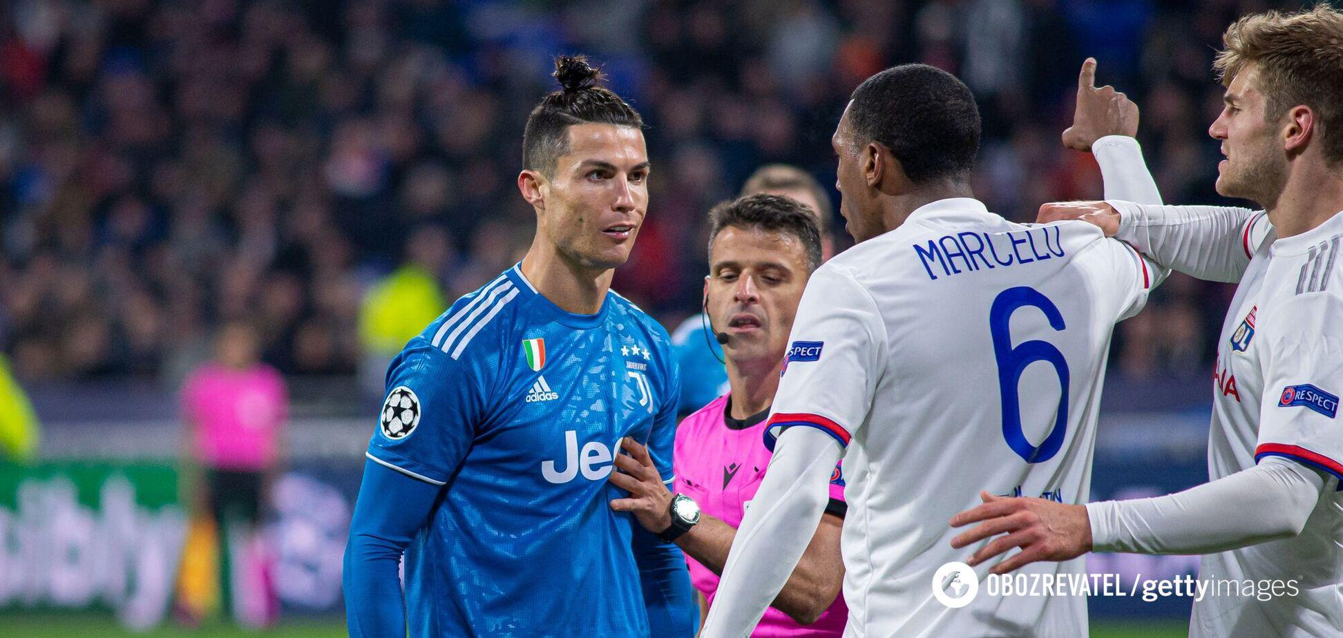 Гравець 'Ліона' Марсело сперечається з Кріштіану Роналду