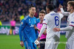 Игрок 'Лиона' Марсело спорит с Криштиану Роналду