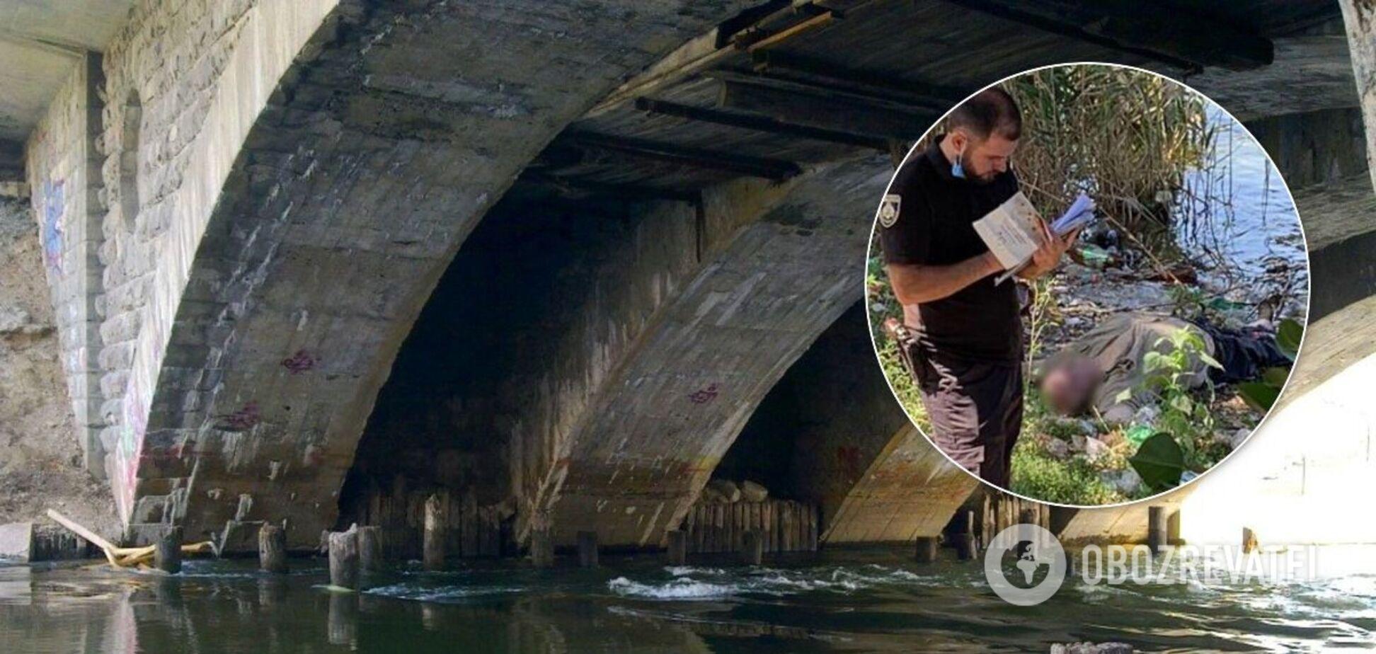 У Кривому Розі в воді під мостом знайшли тіло чоловіка. Фото 18+