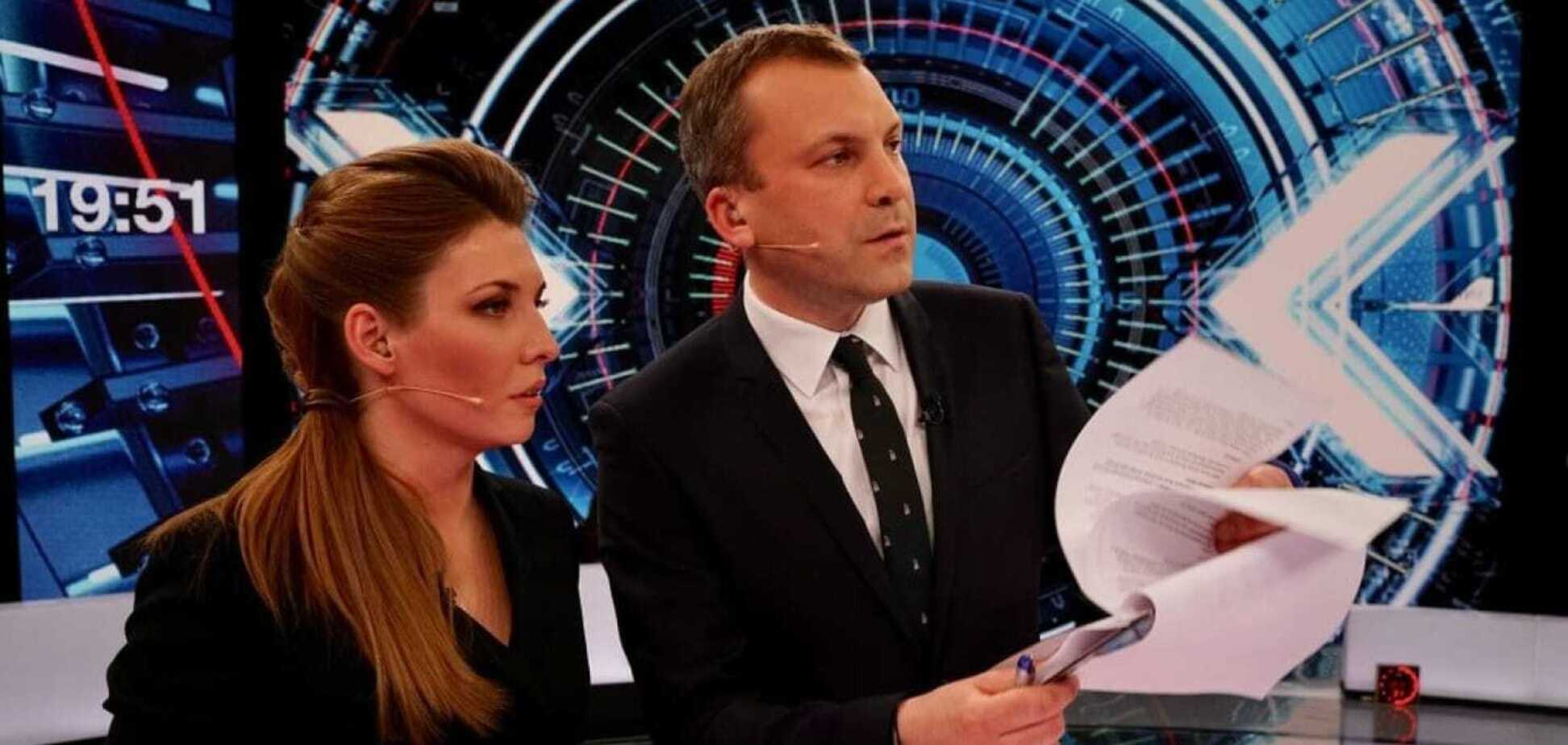 Российские телеведущие Ольга Скабеева и Евгений Попов