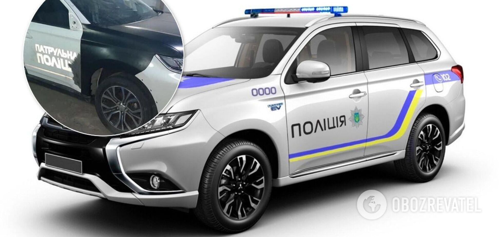 На битый Mitsubishi Outlander поставили дверь от полицейского авто.