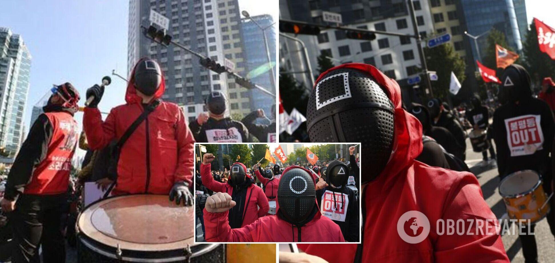 У Південній Кореї десятки тисяч людей вийшли на протести в костюмах з 'Ігри в кальмара': що відбувається. Фото і відео