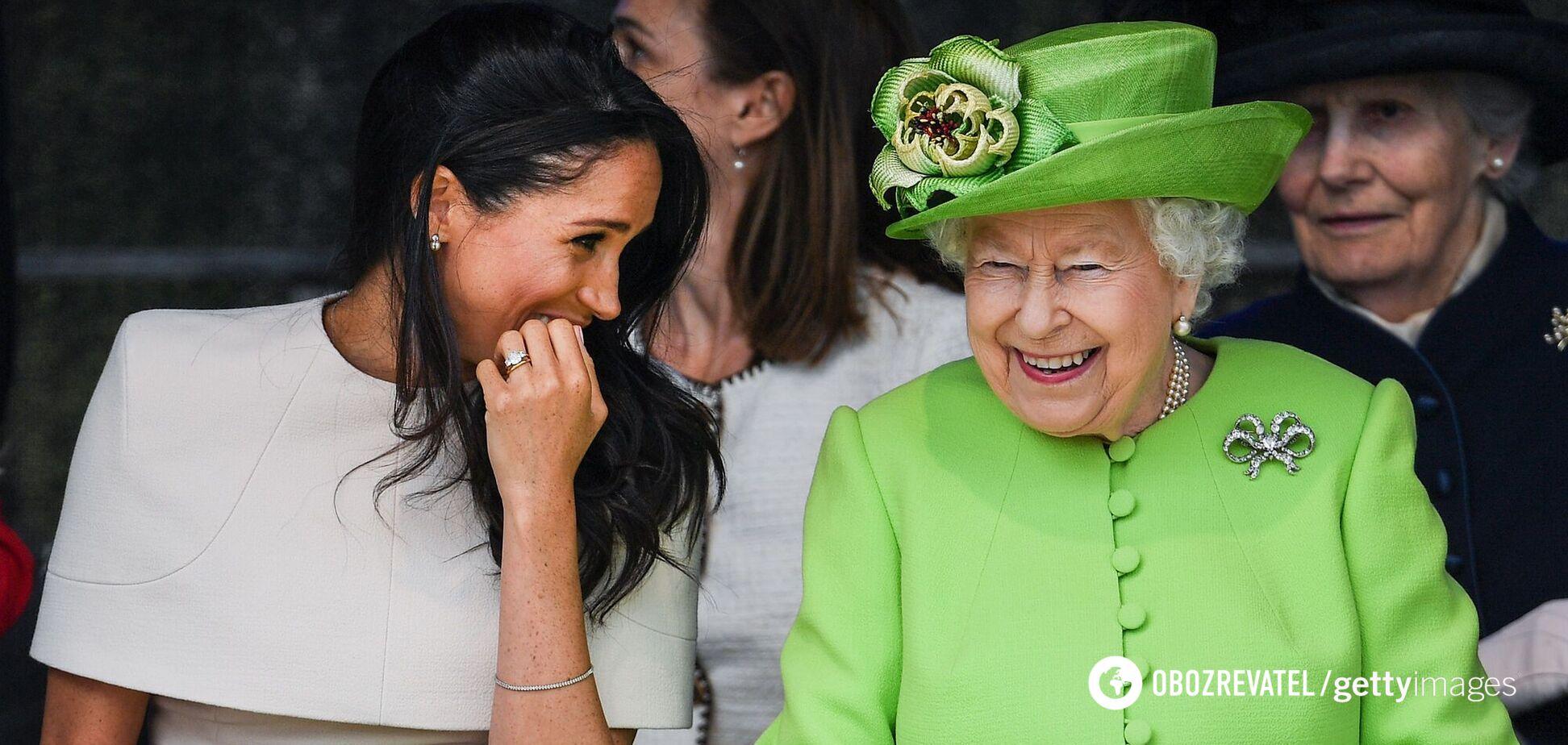 Сharlie Нebdo выпустил обложку с Елизаветой II, душащей Меган Маркл