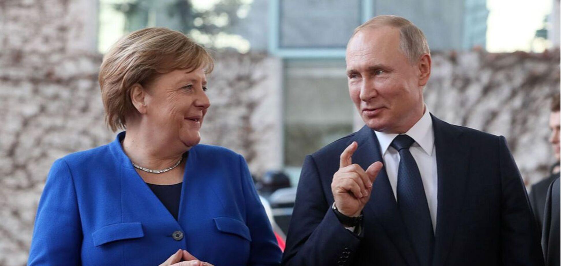 Путін відповів на слова Меркель про стягування військ до кордону з Україною