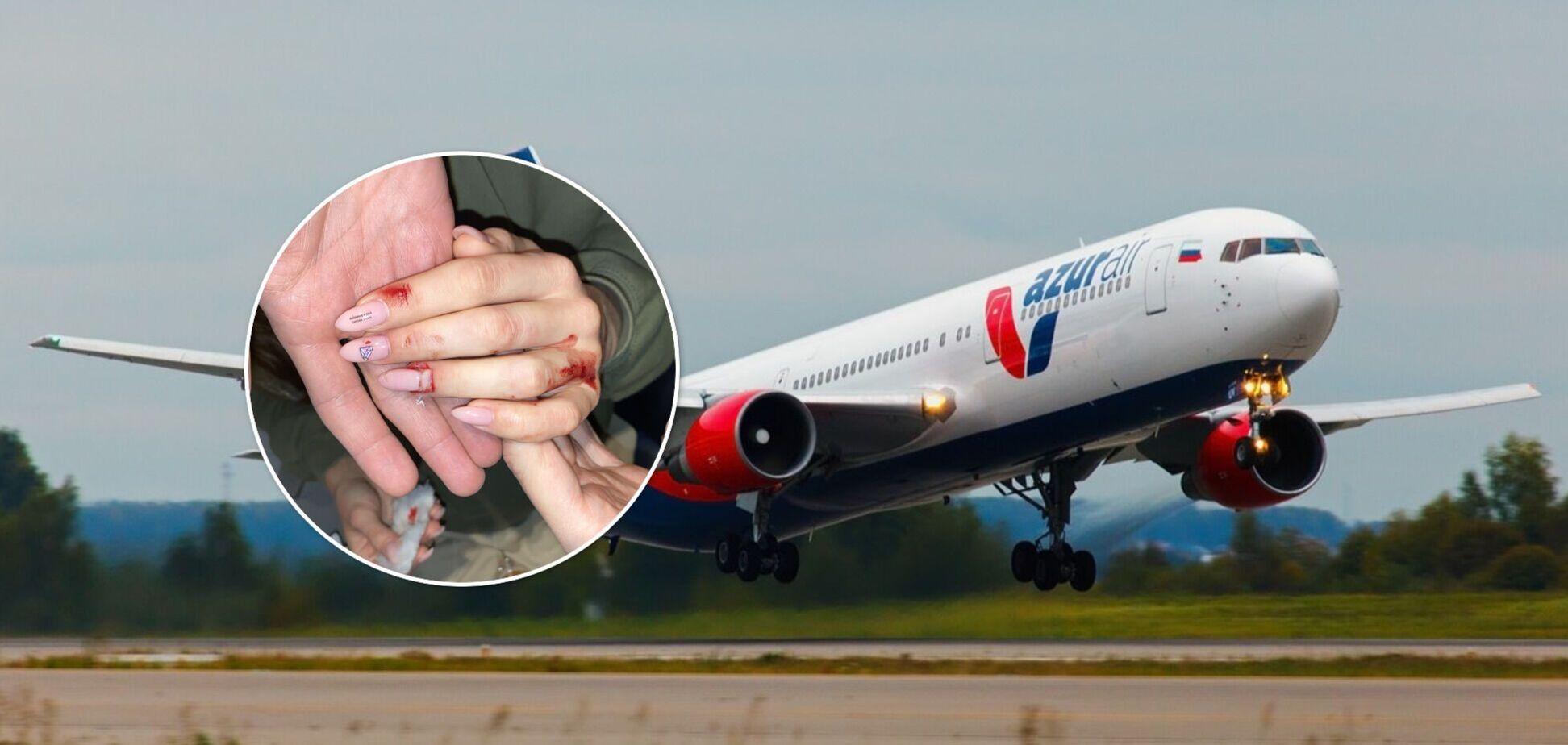 Українці в літаку роздряпали обличчя і відгризли ніготь