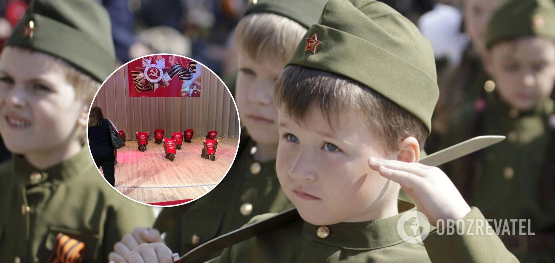 У РФ до 9 травня діти зображали могили загиблих солдат, а в Білорусі – влаштували 'спалення села'. Фото та відео