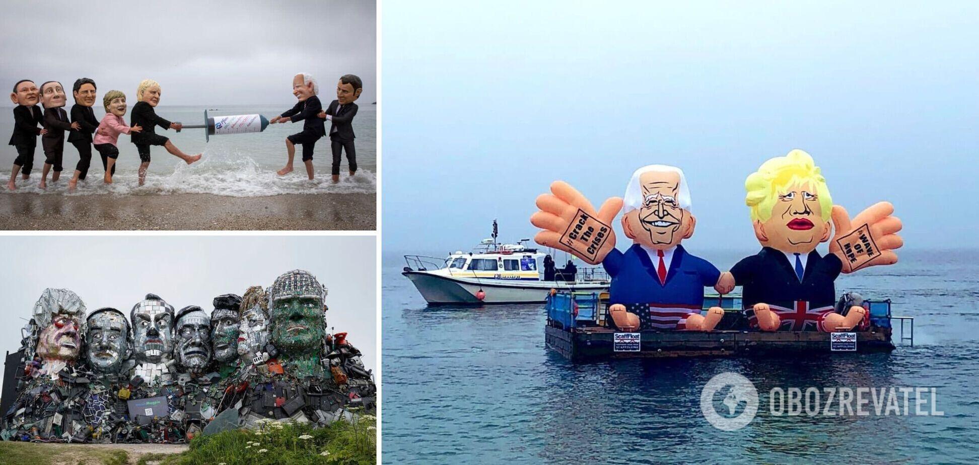 Активісти креативно зустріли учасників G7: надули Байдена і Джонсона та влаштували боротьбу за гігантський шприц. Фоторепортаж