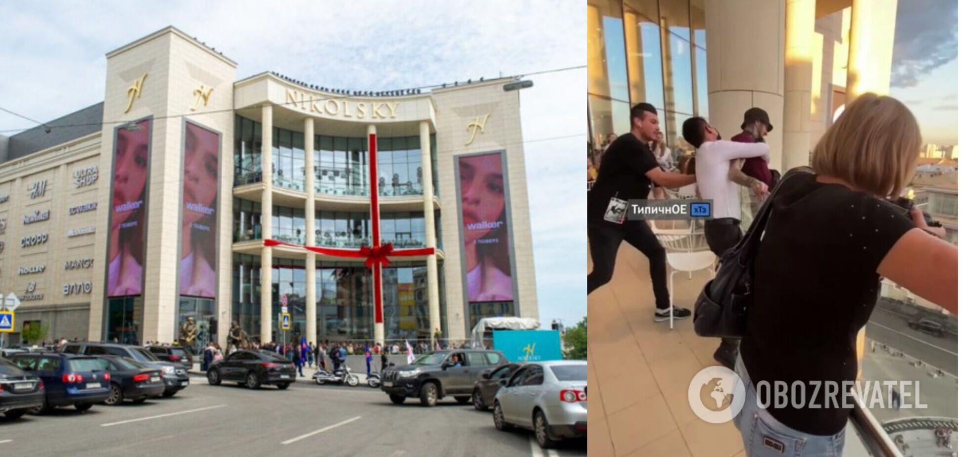 У Харкові самогубець хотів стрибнути з балкона нового ТЦ на очах у людей. Відео спасіння