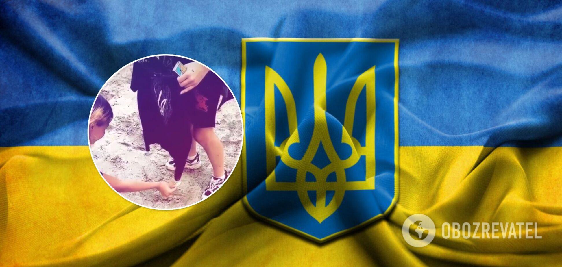Дівчата спалили футболку з гербом України і нарвалися на скандал. Відео