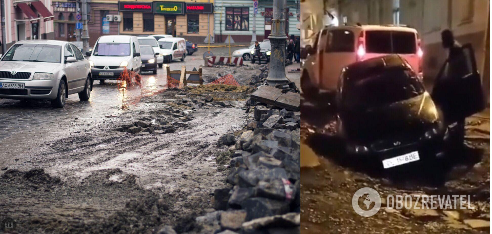 В Черновцах авто провалилось в огромную яму посреди дороги. Видео